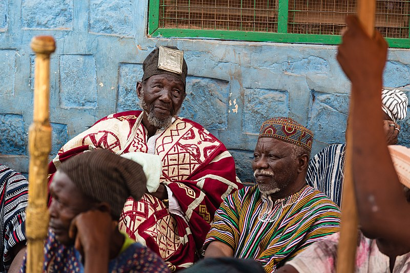 The NaYiri, Overlord of the Traditional Mamprugu Area, sits in front of his palace in Nalerigu, Ghana during an enskinment ceremony for Mamprusi chiefs. He is surround by his traditional council of elders, subchiefs and warriors. NaBɔhaga Mahami Abdulai Sheriga, is the son of the late NaSheriga who ruled as the paramount chief of the Mamprusi in the 1950s and 60s. PHOTO: William Haun