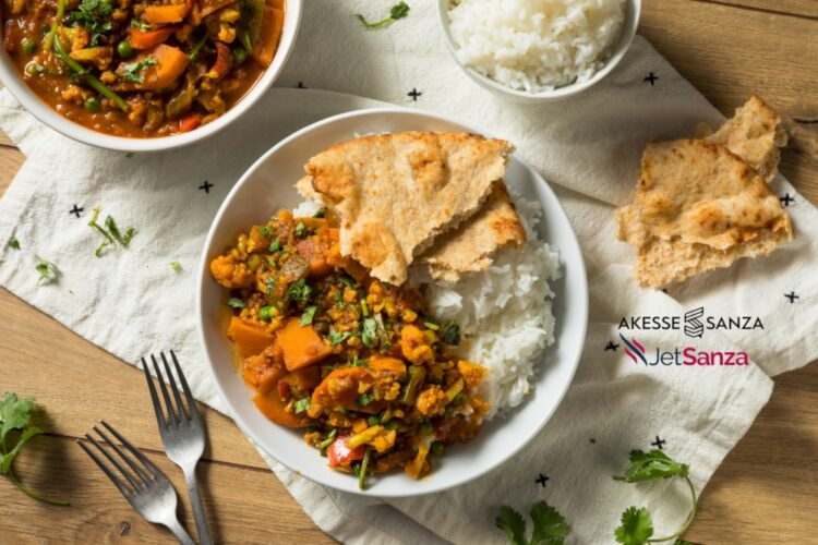 Homemade Spicy Vegan Vegetable Curry with Rice and Naan